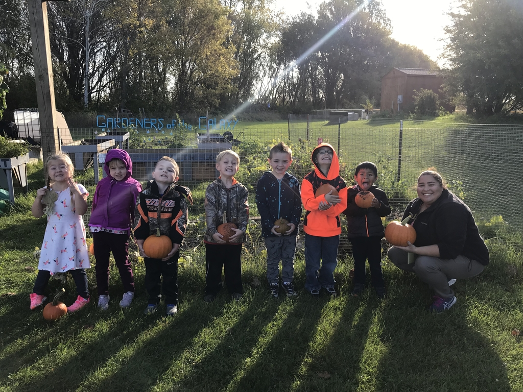Preschoolers with pumpkins.