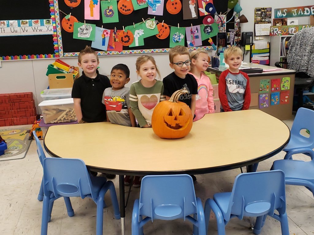 PRESCHOOLERS WITH PUMPKIN