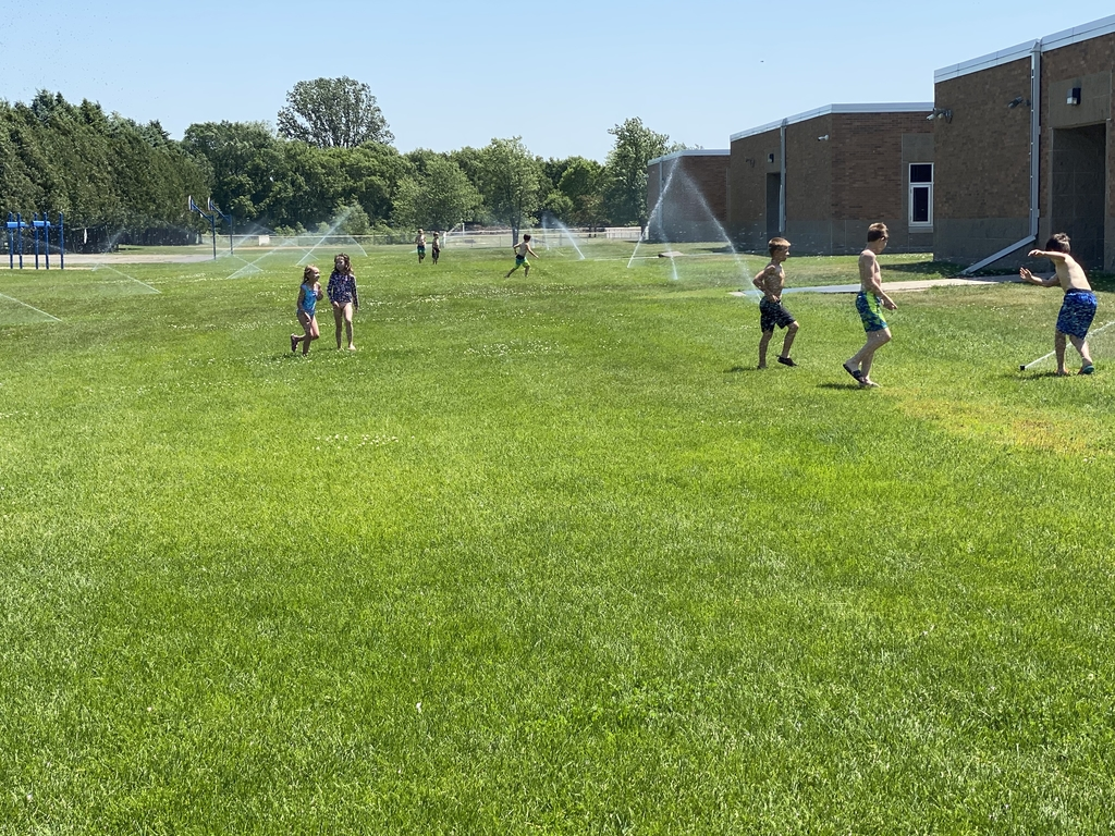 Sprinklers were a great way to cool off after our adventures.